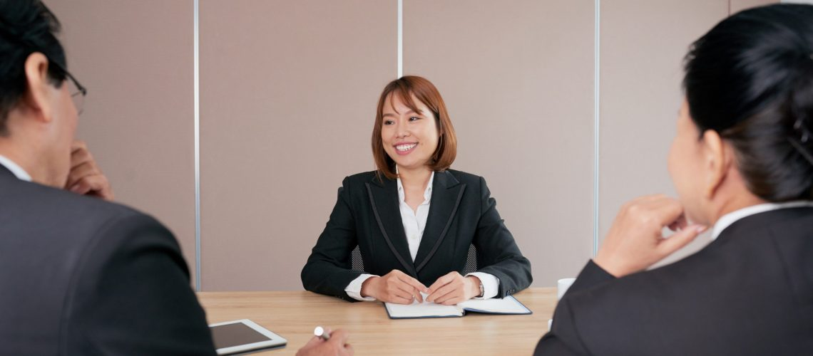 Young Vietnamese business lady conducting a meeting